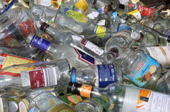 Glass bottles for recycling. White glass bottles for recycling - format-filling in closeup Royalty Free Stock Images