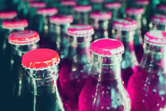 Glass bottles with soft drinks. Background Stock Photos