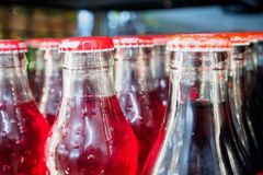 Glass bottles with soft drinks. Background Royalty Free Stock Image