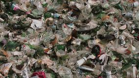 Glass bottles and splitters garbage trash for recycle at the dump. Empty old bottles for renewal recycling earth ecology sorting stock footage
