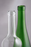 Glass Bottles. Still life portairs of clear and green glass wine bottle tops Royalty Free Stock Images