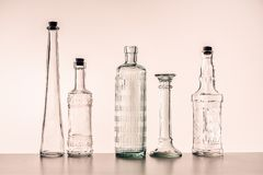 Glass bottles of various shapes Royalty Free Stock Photos
