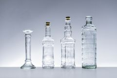 Glass bottles of various shapes Royalty Free Stock Photo