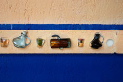 Glass bottles on the wall. Glass bottles on the blue wall Royalty Free Stock Images