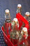 Glass bottles with water. Glass bottles filled with water, reusable Royalty Free Stock Photo