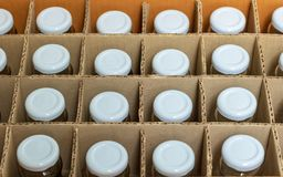 Glass bottles with white bottle caps in a cardboard box, Top vie stock photo