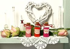 Glass Bottles With Love Potion, Happiness, Magic Elixir, Roses, Heart Symbol And Flasks Stock Images