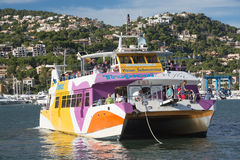 Glass bottom boat in Puerto Andratx. PORT D'ANDRATX, MAJORCA, SPAIN - ON OCTOBER 31 2013: Glass bottom boat, a popular tourist attraction, arriving back in Stock Photography