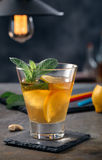Glass of bourbon based cocktail. With lemon and mint Royalty Free Stock Image