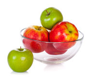 Glass bowl with apples isolated on white Stock Image