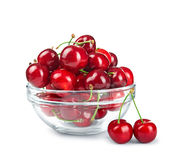Glass bowl with cherries Stock Photos