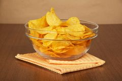 Glass bowl with chips and napkin Stock Image