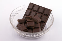 Glass bowl with chocolate Royalty Free Stock Image
