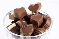 Glass bowl of chocolates Royalty Free Stock Images