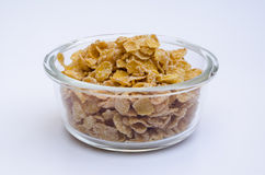 Glass bowl with corn flakes on white background Royalty Free Stock Image