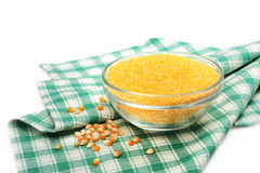 Glass bowl with corn grain on a napkin. On white background Stock Images