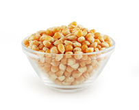 Glass bowl with corn grain. On white background Royalty Free Stock Photo