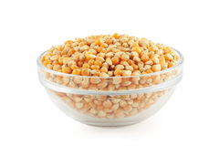Glass bowl with corn grain. On white background Stock Photography