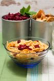 Glass bowl with cornflakes mixed with cranberries Royalty Free Stock Images