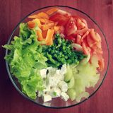 Glass bowl with cutted vegetables for a salad. stock photo