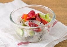 Glass Bowl with Delicious Fresh Fruits Salad Stock Image