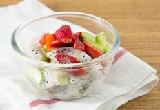 Glass Bowl with Delicious Fresh Fruits Salad Royalty Free Stock Images