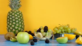 Glass bowl with delicious fruit salad stock footage