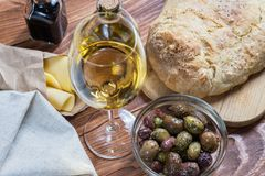 Glass bowl with different kind of olives Royalty Free Stock Image