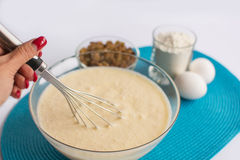 Glass bowl with dough and whisk in a  hand, set of product Stock Image