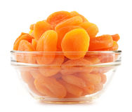 Glass bowl with dried apricots on white Stock Photo