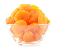 Glass bowl with dried apricots on white Royalty Free Stock Image