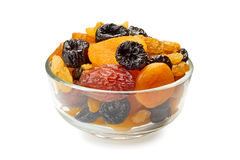 Glass bowl of dried fruits mix on white Stock Image