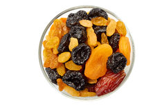 Glass bowl of dried fruits mix on white Royalty Free Stock Photography