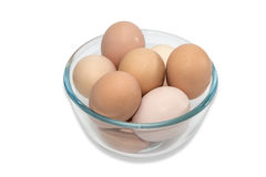 Glass bowl with eggs Stock Images