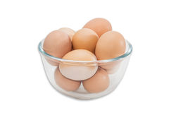 Glass bowl with eggs Stock Photos