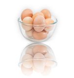 Glass bowl with eggs Stock Photography