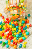 Glass bowl fallen with jelly beans Stock Photos