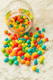 Glass bowl fallen with jelly beans Stock Photo