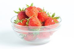 Glass bowl filled with ripe and juicy strawberries. On white background Stock Photos