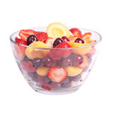 Glass bowl with fresh fruits. Salad isolated on white Stock Image