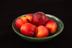 Glass bowl with fresh plums Stock Image