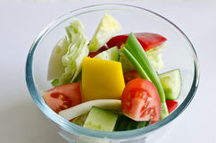 Glass bowl of fresh salad Stock Images