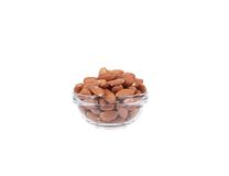 Glass bowl full with almonds. Stock Photo