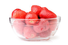 A glass bowl full of fresh strawberries. stock photography