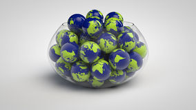 Glass bowl full of globes Stock Photos