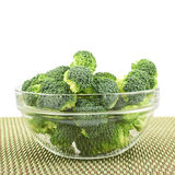 Glass bowl full of green broccoli. Pieces Royalty Free Stock Image