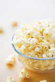 Glass bowl full of popcorn. Close up Royalty Free Stock Photos