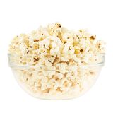 Glass bowl full of popcorn isolated Stock Photo