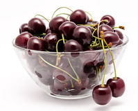 A glass bowl full with sweet cherries isolated Stock Photography
