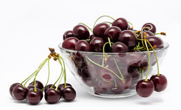 A glass bowl full with sweet cherries  on a white Royalty Free Stock Image